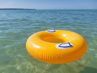 Orange rubber ring in the sea