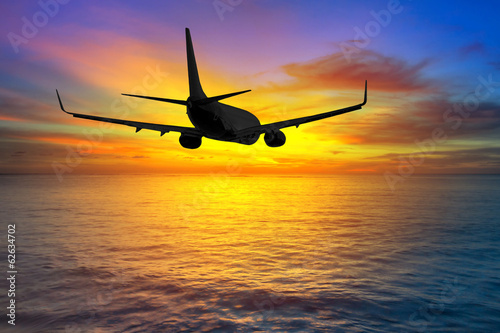 Aircraft flying on the sky at sunset
