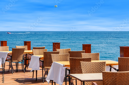 Restaurant on terrace with sea view in Kemer, Turkey.