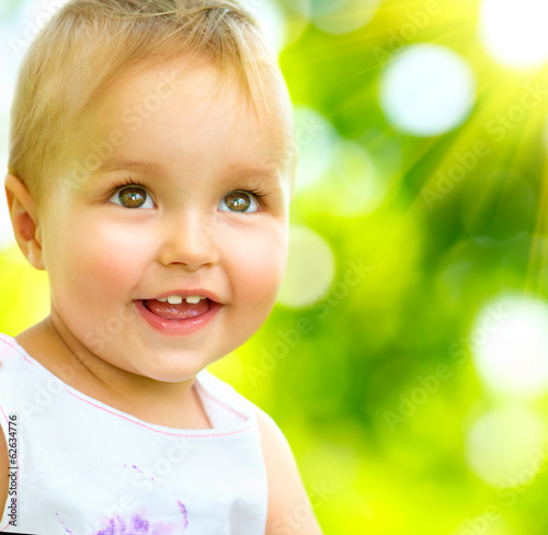 Little Baby Girl Portrait Outdoor. Smiling Cute Child