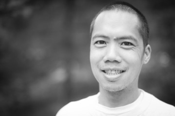 Black and white portrait of middle aged Asian male
