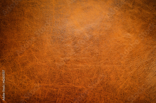 Foto op Canvas Stof Brown leather textured background with side light.