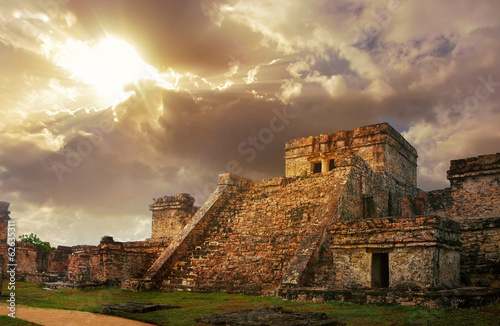 Leinwanddruck Bild Castillo fortress at sunrise in the ancient Mayan city of Tulum,