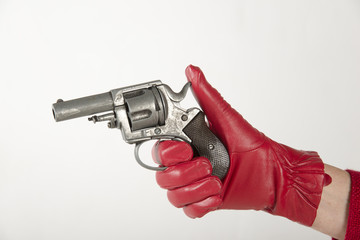 Woman wearing red glove holding a gun