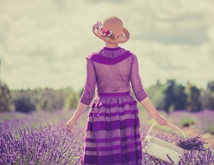 Retro style woman in a lavender field