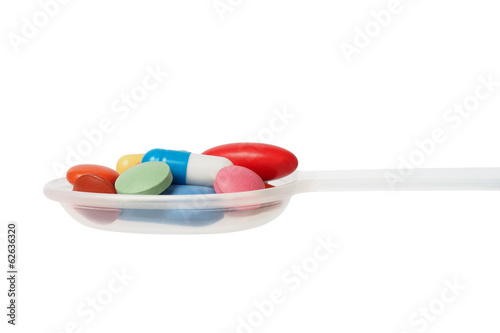 Medicine spoon with pills