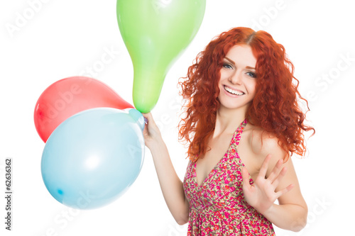 Joyful girl holding colorful balloons