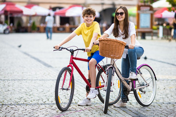 Urban biking - teens riding bikes in city