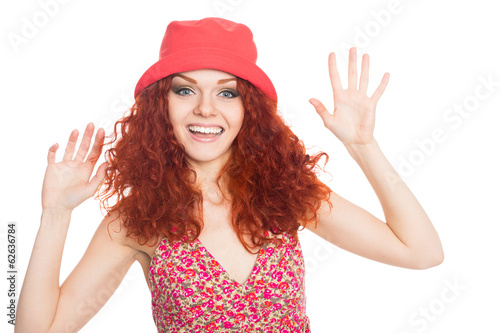 Joyful young woman in a red hat