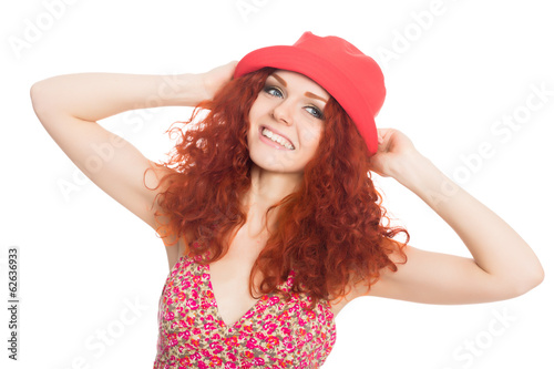 Joyful girl in a red hat isolated on white.