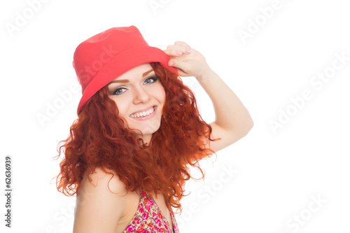 Joyful girl in a red hat isolated on white