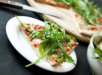 Slice of Pizza Margherita with Arugula