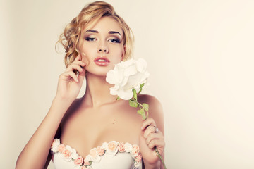 portrait of beautiful blond woman with rose