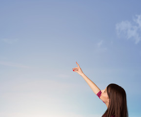 Girl looking at the blue sky copyspace