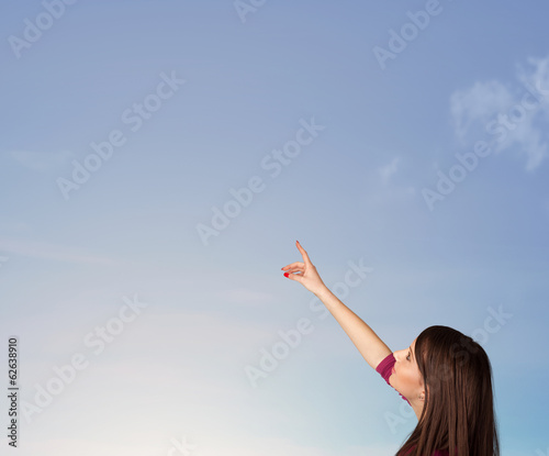 canvas print picture Girl looking at the blue sky copyspace