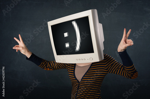 Funny girl with a monitor box on her head and a smiley face