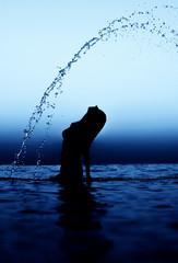 Woman in water waving hair. Aqua effect.
