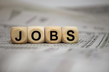 Jobs mit Würfel und Zeitung