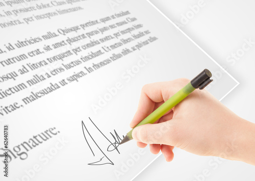 Hand writing personal signature on a paper form