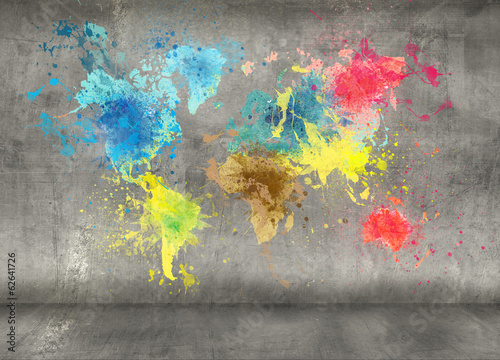 Leinwanddruck Bild world map made of paint splashes on concrete wall background