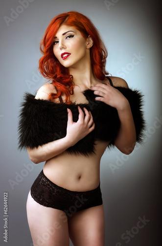 Sensual redhead woman posing in black lingerie