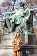 woman standing by Johann Wolfgang Goethe's statue, Vienna, Aust