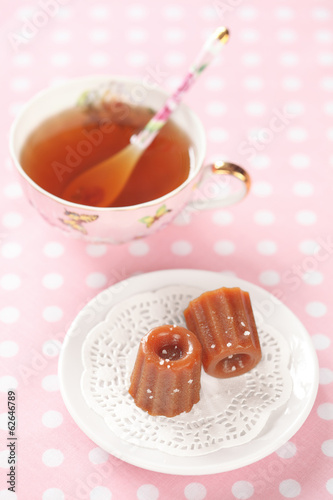 Salted Caramels on a white plate, with a cup of tea.