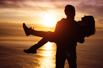 Couple in love at sunset having fun
