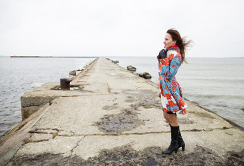 Woman posing at dam at windy day
