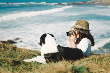 Funky woman taking photo to her dog
