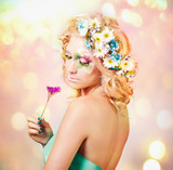 Beautiful young woman with delicate flowers in their hair