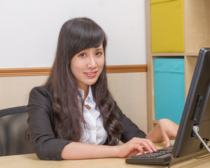 Chinese businesswoman at desk