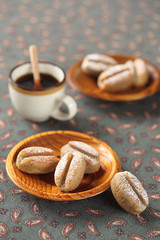 Coffee Madeleine Cookies with a cup of coffee.