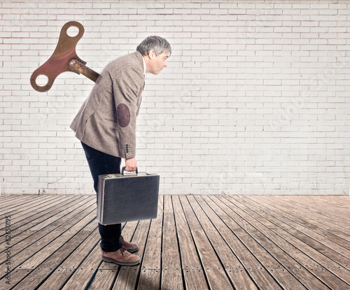 businessman with a wind up key