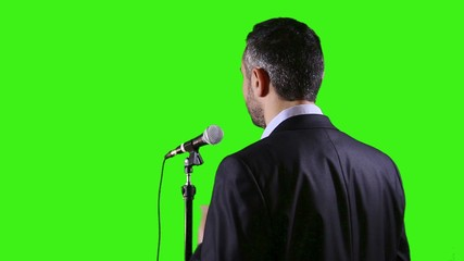 speaker with microphone on green screen