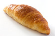 Single croissant on white surface