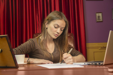 Writing elite pen on white A4 document signing contract