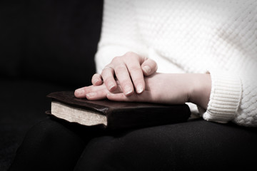 Praying woman with her bible