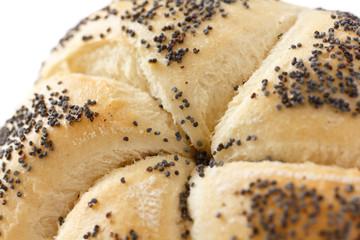 White poppy seed Kaiser bread roll on white