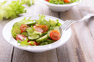 Salad from cucumbers and tomatoes in white plate