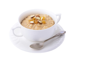 Oatmeal porridge with almonds and raisins on white background