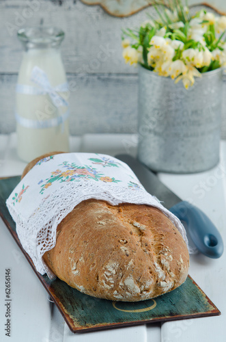 Rustic bread on a white wooden board