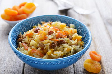 Pilaf with dried apricots and raisins