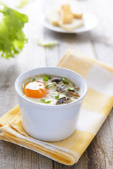 Healthy lunch: baked egg with mashrooms and chive