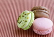 different colorful macaroons (pistachio, raspberry, chocolate)