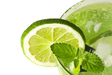 slice of lime in glass with ice and mint mojito