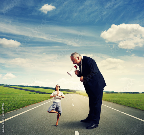 man screaming at small woman on the road