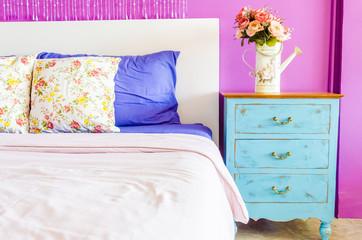Interior bed room vase flower on wood beside bed table