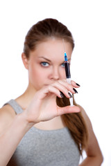 girl about a syringe in  hand on  white background