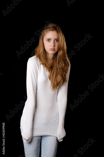 The girl in  white sweater on a black background